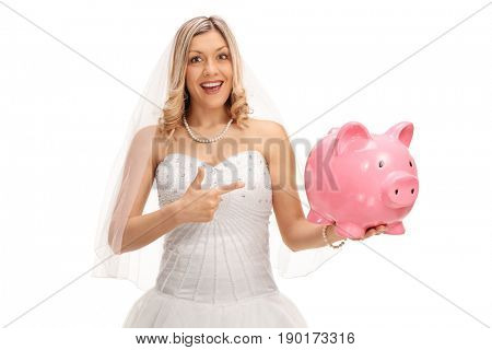 Young bride holding a piggybank and pointing isolated on white background