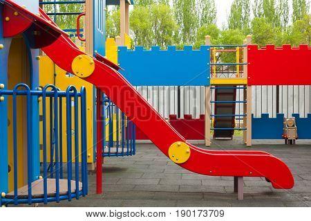 Children playground with metal slide. Kid's colorful area.Modern children playground in park