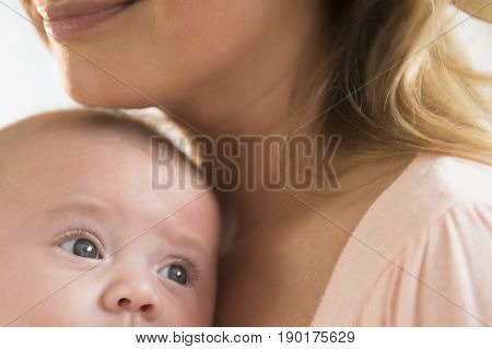 Caucasian mother smiling with baby