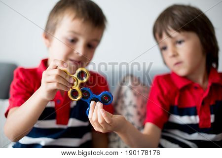 Little Children, Boy Brothers, Playing With Colorful Fidget Spinner Toys