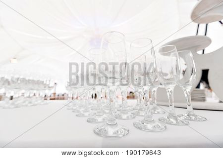 Many empty glasses in a line. the buffet in the restaurant. Banquet wedding or anniversary