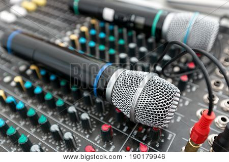 Microphone and sound mixer in public area concert stage. the bright day. Concert or event on the street