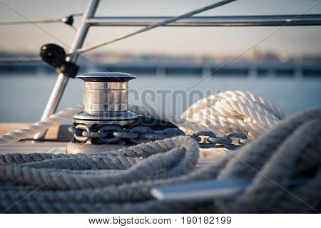 Windlass and mooring rope on sailing boat in the early morning in the Marina