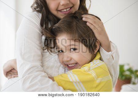Hispanic children hugging