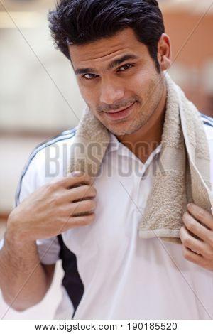 Hispanic man smiling in gym