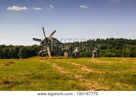 Wooden Windmills In The Village