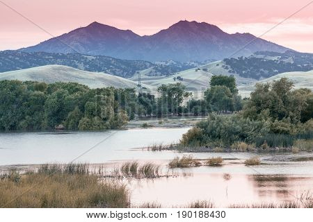 Mount Diablo Sunset from Marsh Creek Reservoir. Brentwood, Contra Costa County, California, USA.