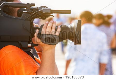 The operator photographer takes on a professional camera interviews in the mass celebration.
