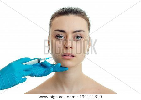 close-up portrait of a young girl whose doctor makes injection on face isolated on white background poster