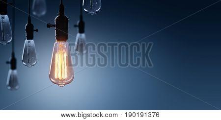 Innovation And Leadership Concept - Glowing Bulb On Among Bulbs Off