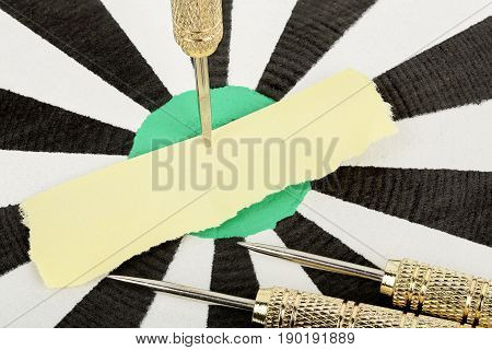 blank paper on dart board for your message