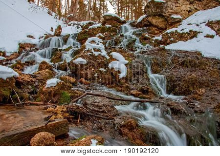 Kazu grava cascading waterfall with some snow drifts