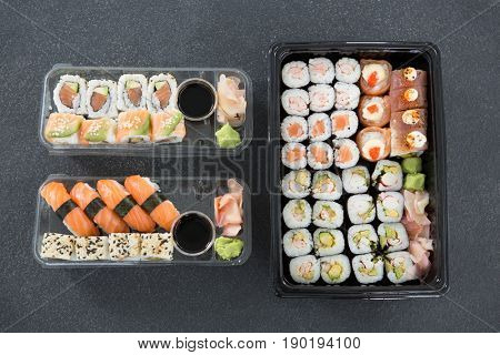Various sushi rolls in platter with soy sauce
