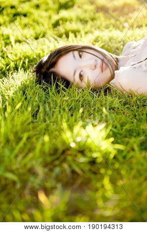 Chinese woman laying in grass