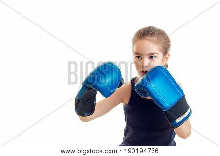 little girl boxer in blue gloves isolated on white background