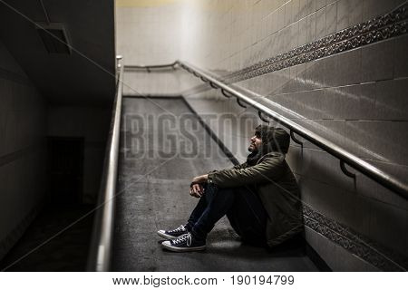 Cold Adult Man Sitting Hopeless Thoughtful on the Ramp