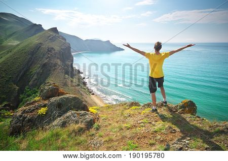 Man enjoy the nature. Sea and mountain.