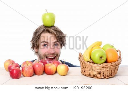 Amazed Happy Man With Apple On Head And Red Apples