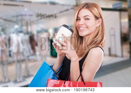 Smiling Girl With Shopping Bags In The Mall