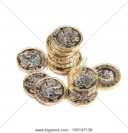 British one pound coins on white background