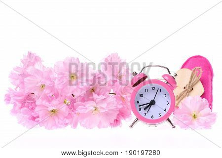 Branch Of Sakura Flowers With Pink Alarm Clock And Heart