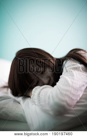 woman feel depression and lying on the bed