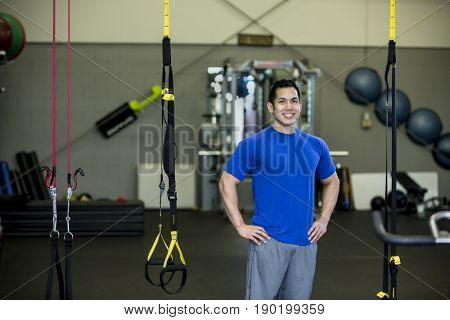 Pacific Islander man standing in gym