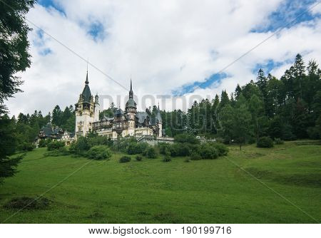 beautiful view at the Peles Castle Sinaia Romania Europe. summer cloudy sky. distance view