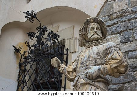 medieval marble gesso statue of courtier at Peles castle Romania