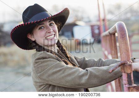 Caucasian girl smiling on farm