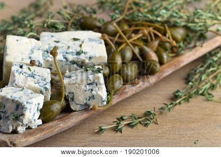 Blue Cheese , Capers And Branches Of Thyme.