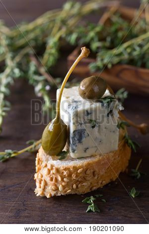 Blue Cheese , Capers And Branches Of Thyme .