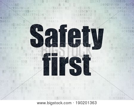 Privacy concept: Painted black word Safety First on Digital Data Paper background