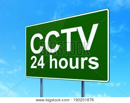 Privacy concept: CCTV 24 hours on green road highway sign, clear blue sky background, 3D rendering