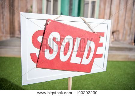 Sale Banner With Sold Card Standing Near New House