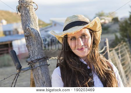 Caucasian woman smiling by barbed wire fence