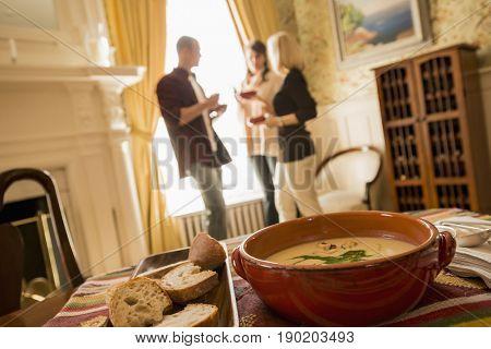 Caucasian friends talking in dining room