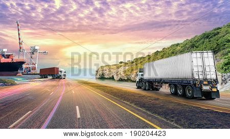 Logistics import export background and transport industry of Container truck on the road with Cargo ship at sunset sky
