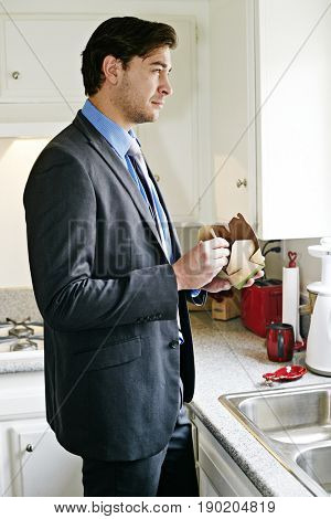 Caucasian businessman eating take out food
