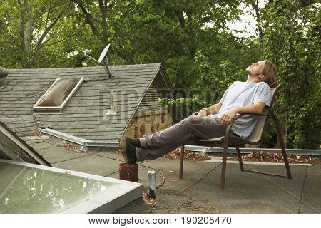 Man relaxing on roof