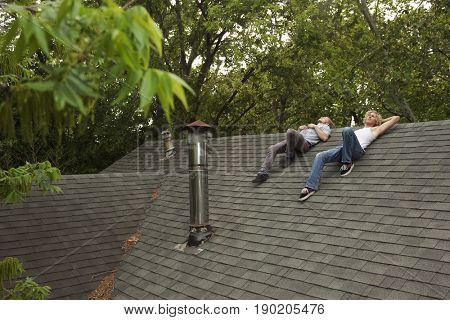 Friends hanging out on roof together