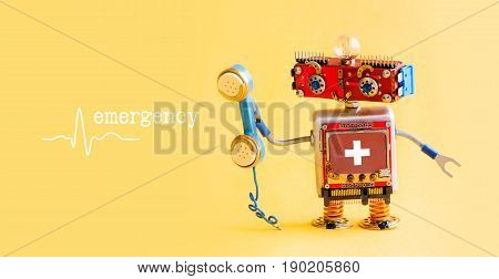 Emergency helpline medical service call center concept. Friendly robot doctor with retro styled phone. First aid advertisement template poster. Friendly toy character on yellow background