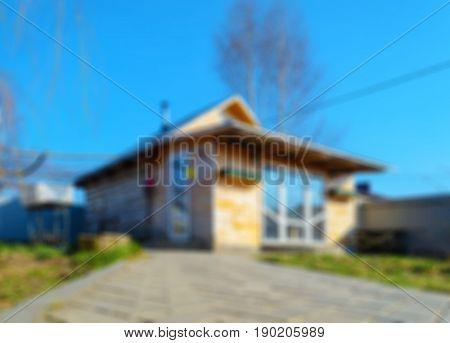 Blur bathhouse exterior with an adjacent stepped path