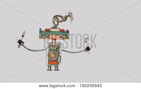 Cooking kitchen chef fork and spoon in arms. Funny toy robot for restaurant food menu advertising poster. Cyborg made electric wires transistors electronic on gray background. Copy space photo.