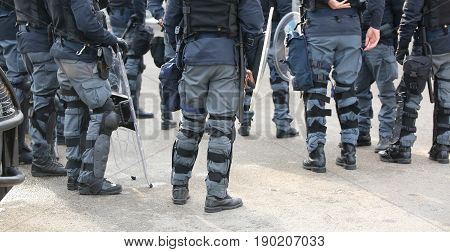 Group Of Police Officers In Riot Control With Batons During Secu