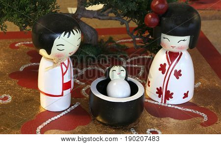 Representation In The Japanese Style Crib With Statuettes