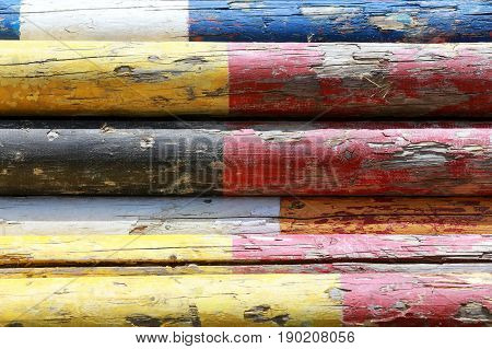 Colorful image of show jumping poles stacked at the show jumping arena