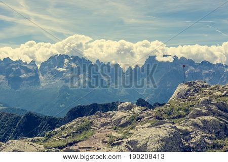 Mountain trail in front of Brenta Group. Madonna di Campiglio, Italy.
