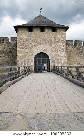 Entrance gate to the Khotyn castle. Castle tower and wooden bridge to the castle gate