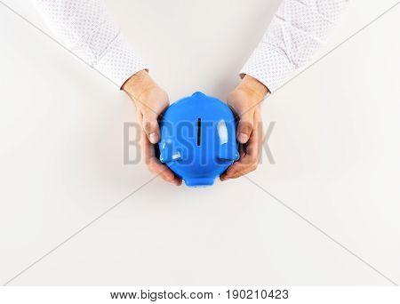 man holding piggy bank . top view